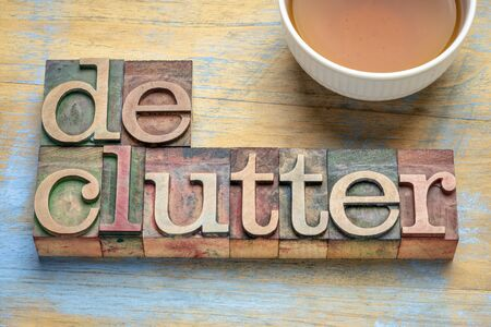 declutter word - text in letterpress wood type with a cup of tea, business or lifestyle  minimalism concept Banque d'images