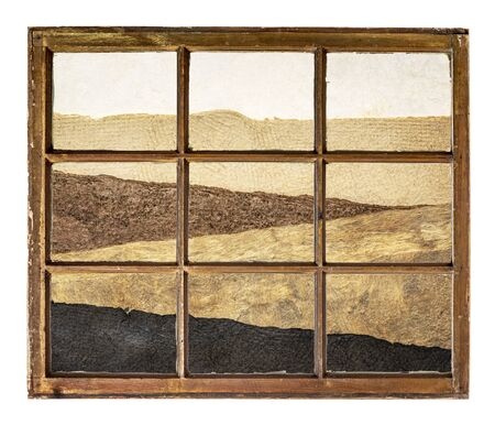 abstract desert landscape created with handmade sheets of rough paper as seen through a vintage sash window Standard-Bild - 129422190