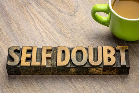 self doubt - word abstract in vintage letterpress wood type, personal development and confidence concept