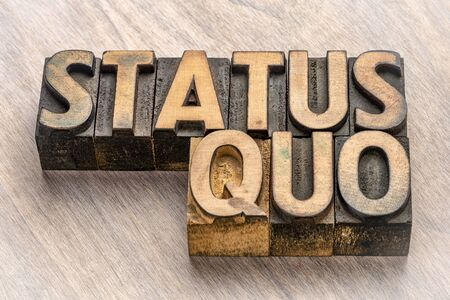 status quo word abstract in vintage letterpress wood type, normality and stability concept