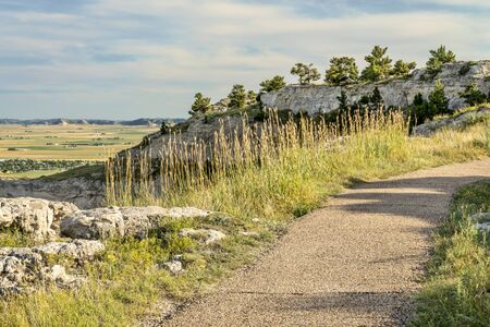 walking trail at the summit of Scotts Bluff National Monument, late summer of early fall scenery, visiting national parks concept