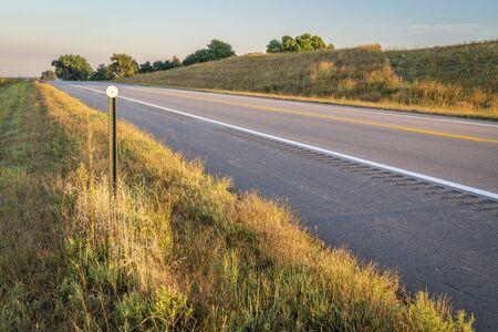 highway in Nebraska Sandhills, late summer or early fall scenery in morning light