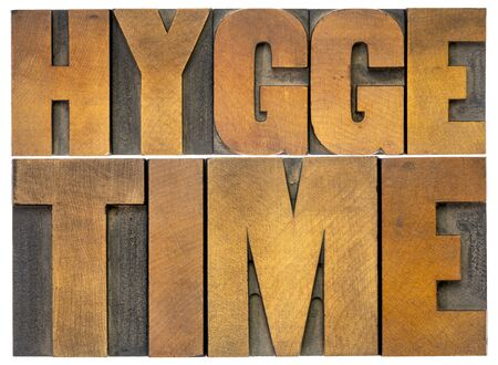 hygge time - isolated word abstract in vintage letterpress wood type blocks, Danish lifestyle concept 스톡 콘텐츠