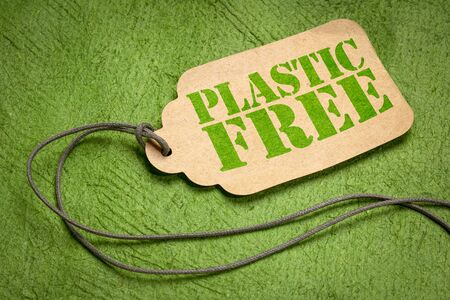 plastic free sign - a paper tag with a twine on green textured paper