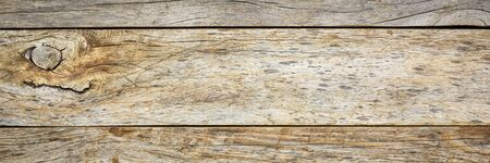 weathered barn wood background with knots and nail holes, rough wooden texture in a long banner format