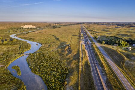 highway and railroad along the Middle Loup River in Nebraska Sandhills, late summer aerial view