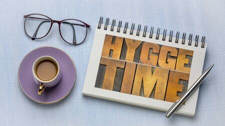 hygge time  word abstract in vintage letterpress wood type in a sketchbook, Danish lifestyle concept