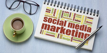 social media marketing concept - a word cloud in a sketchbook with a cup of coffee Stok Fotoğraf