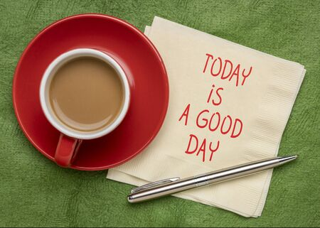 today is a good day note  - positive handwriting on a napkin with a cup of coffee Banco de Imagens