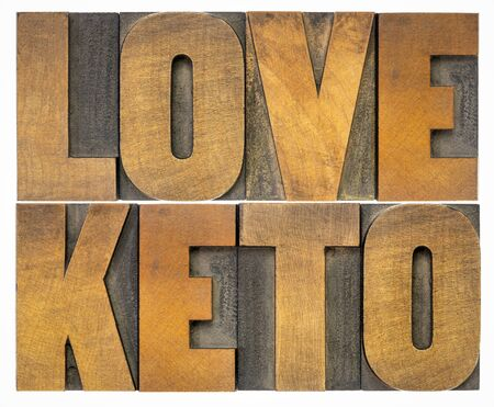 love keto - isolated word abstract in vintage letterpress wood type, healthy ketogenic diet with high fats and low carbs concept
