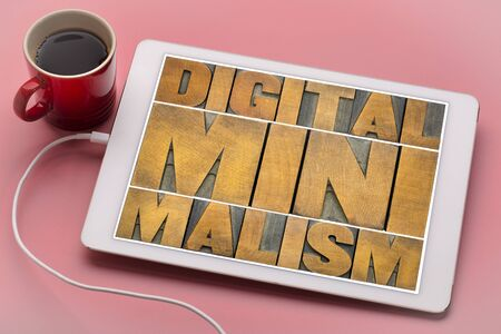 digital minimalism concept - word abstract in letterpress wood type blocks on a tablet with a cup of coffee