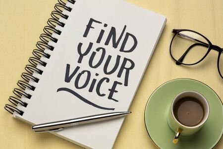 Find your voice text -inspirational handwriting in a sketchbook  with a cup of coffee, communication, brand, personality and identity concept