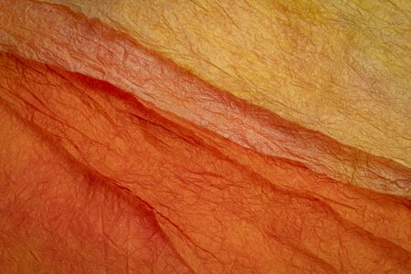 background of orange and red marbled momi paper