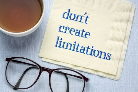 do not create limitations - inspirational handwriting on a napkin with a cup of tea, business, self growth and personal development concept Reklamní fotografie