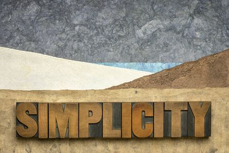 simplicity word  in vintage letterpress wood type against abstract paper landscape, minimalism concept Stock Photo