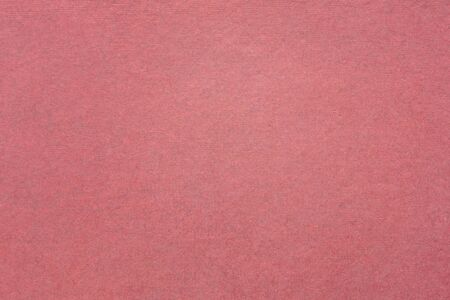 background and texture of rose pink handmade Indian paper created from recycled cotton fabric