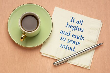 It all begins and end in your mind - inspirational handwriting on a napkin with a cup of coffee, creativity, attitude and mindset concept