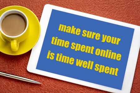make sure your time spent online is time well well spent - digital minimalism advice, text on a digital tablet with a cup of coffee