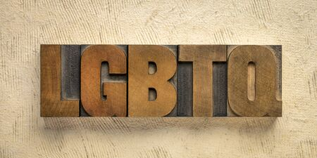 LGBTQ initialism that stands for lesbian, gay, bisexual, transgender and queer. Word abstract in vintage letterpress wood type blocks. Diversity of sexuality and gender identity-based cultures concept.