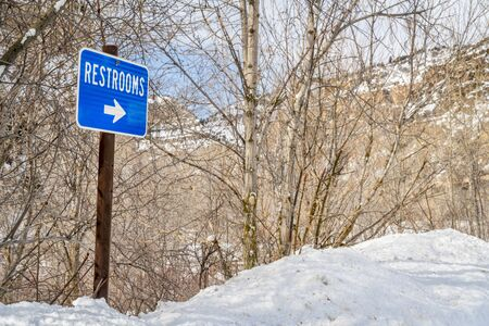 restrooms sign in one of rest areas in Glenwood Canyon, Colorado in winter scenery, travel concept