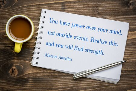 You have power over your mind, not outside events ... - ancient Roman Emperor and stoic philosopher Marcus Aurelius inspirational quote - handwriting in an  art sketchbook against grained wood with a cup of coffee, personal development and self improvement concept. Banco de Imagens
