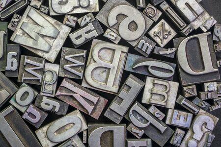 background of random vintage grunge letterpress metal type printing blocks Standard-Bild