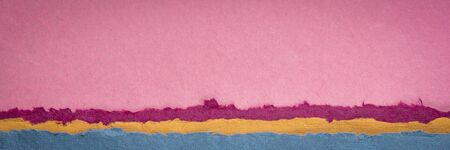 pink sunrise or sunset over sea abstract landscape - a collection of colorful handmade Indian papers produced from recycled cotton fabric, panoramic web banner