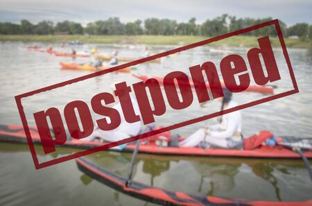 postponed river paddling race, event cancelation due covid-19 coronavirus pandemic, social distancing concept Imagens