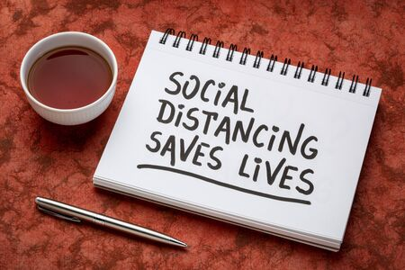 social distancing saves lives reminder - handwriting on a sketchbook, covid-19 coronavirus pandemic recommedation
