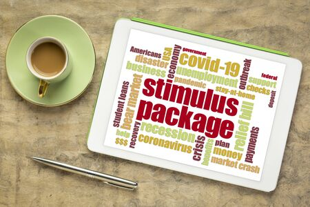 stimulus package word cloud on a digital tablet, relief bill during covid-19 coronavirus pandemic concept