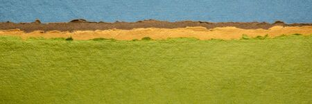 blue sky and green fields abstract landscape - a collection of colorful handmade Indian papers produced from recycled cotton fabric, panoramic web banner
