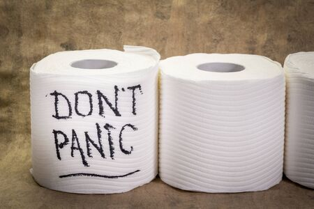 don't panic message - handwriting on a roll of a toilet paper, covid-19 coronavirus pandemic and crisis Zdjęcie Seryjne