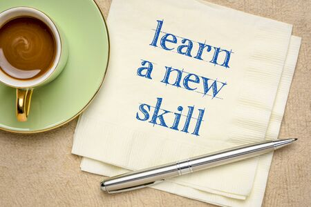 learn a new skill motivational note - handwriting on a napkin with a cup of coffee, personal development and growth concept