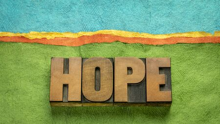 hope word - word abstract in vintage letterpress wood type against abstract paper landscape, positivity, faith and optimism concept Standard-Bild