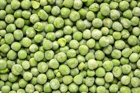 closeup background of frozen green peas