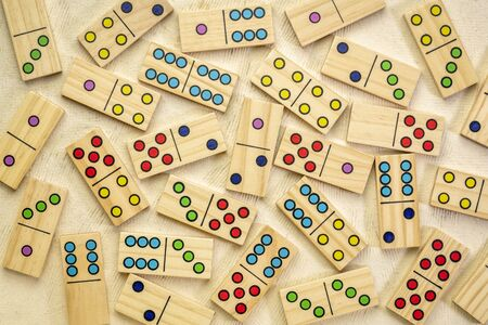 background of random wooden domino pieces on textured bark paper