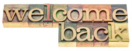 Welcome back sign - isolated text in letterpress wood type, business reopening concept