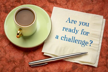 Are your ready for a challenge? Handwriting on napkin with a cup of coffee. Business, competition, test or personal development concept. Stock Photo