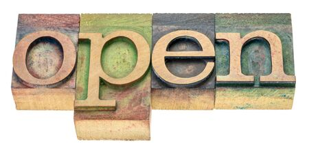 open - isolated word abstract in letterpress wood type stained by color inks Stock Photo