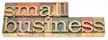 small business - isolated word abstract in vintage letterpress wood type stained by color inks