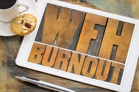 WFH (work from home) burnout - word abstract in vintage letterpress wood type on a digital tablet, telecommuting and emotional, mental, or physical exhaustion concept