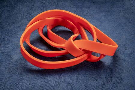 resistance exercise band for fitness and rehabilitation against blue textured background