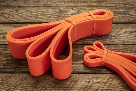 resistance exercise band for fitness and rehabilitation against wooden background