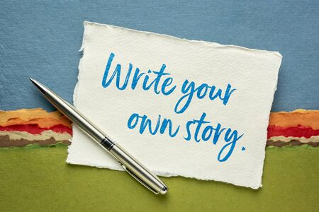 write your own story inspirational note - handwriting on a handmade rag paper against abstract landscape, creativity and personal development concept Stock Photo