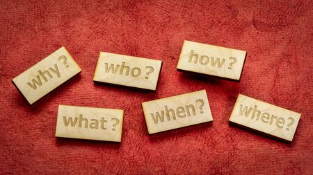 decision making or brainstorming questions - text engraved in wooden block against red textured paper background Stock Photo
