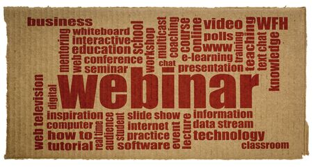 webinar word cloud on a piece of corrugated cardboard, web seminar, telecommuting and internet communication concept Stock Photo