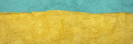 blue and yellow - abstract landscape created with colorful sheets of handmade textured paper, long web banner