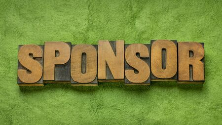 sponsor word abstract in vintage letterpress wood type against handmade paper, help, support, business and finance concept Stock Photo