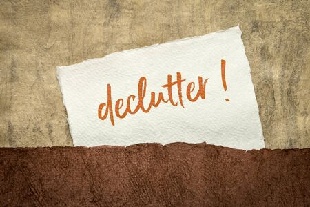 declutter ! Motivational handwriting on a handmade textured paper, simplicity, minimalism and lifestyle concept Stock Photo