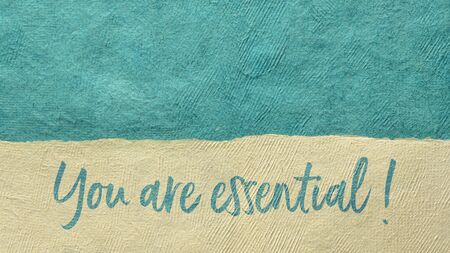 you are essential  - inspirational handwriting against abstract paper landscape, positive affirmation concept Stock Photo